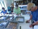 Collections Care volunteers packing historic tile.