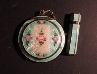 Green enamaled compact case with chain attached lipstick, manufactured by FMCO, ca. 1920s.