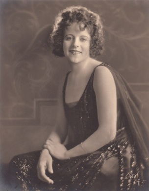 Young woman dressed in flapper fashion, ca. 1920s.