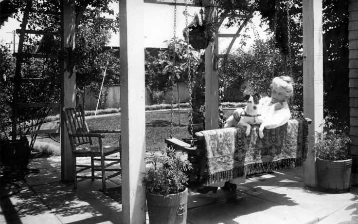 MRS Allison And Dog On Patio Swing In Backyard 2011.111.1.4